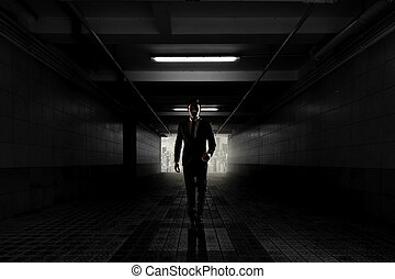Confident businessman walking toward you, silhouette in a...