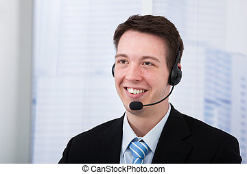 Confident Businessman Wearing Headset In Office
