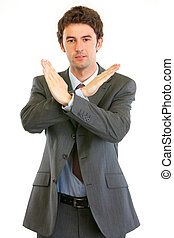 Confident businessman with crossed arms. Forbidden gesture