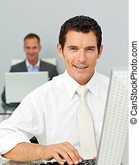 Confident businessman working at his computer