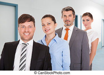 Confident Businesspeople Smiling Together In Office