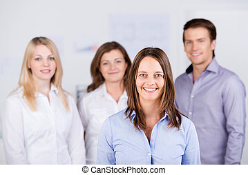 Confident Businesspeople Standing At Office