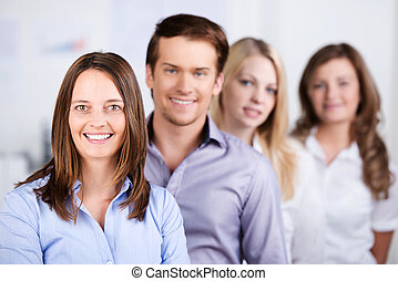 Confident Businesspeople Standing In A Row At Office