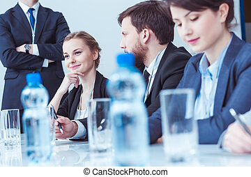 Confident businesswoman at board meeting