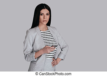 Confident businesswoman. Gorgeous young woman in smart...