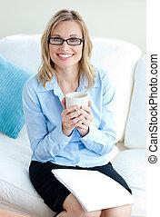 Confident businesswoman holding a p