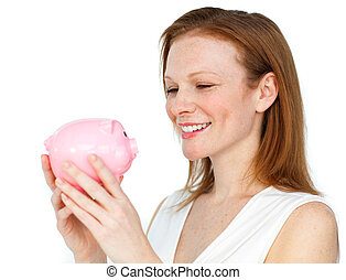 Confident businesswoman holding a piggybank