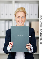 Confident Businesswoman Holding Application File