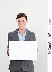 Confident businesswoman holding white card
