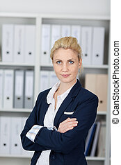 Confident Businesswoman In Front Of Folders