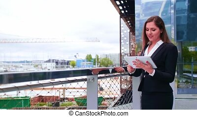 Confident businesswoman in front of modern office building....