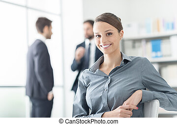 Confident businesswoman posing in the office