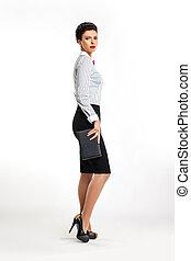 Full length portrait of confident young business woman secretary with handbag sideways