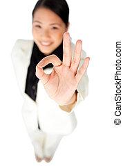 Confident businesswoman showing OK sign
