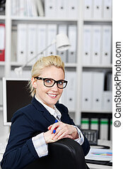Confident Businesswoman Smiling At Work