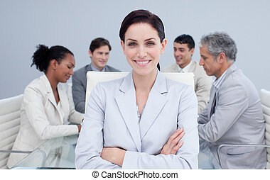 Confident businesswoman smiling in a meeting