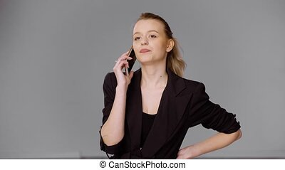 Confident businesswoman talking on smartphone