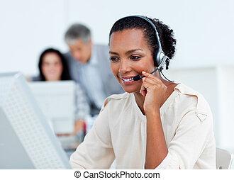 Confident businesswoman talking on headset