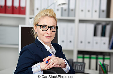 Confident Businesswoman Wearing Glasses At Work