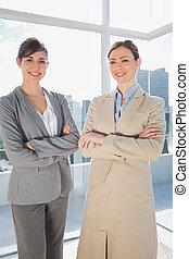 Confident businesswomen smiling at camera