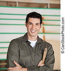 Confident Carpenter Holding Ruler