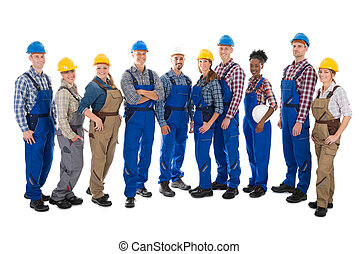 Confident Carpenters Standing In Row - Full length portrait ...
