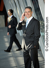 Confident CEO on the phone