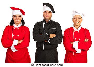 Confident chefs teamwork - Confident chef teamwork standing...