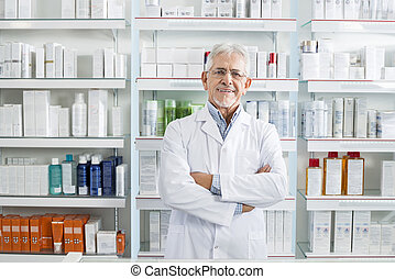 Confident Chemist Standing Arms Crossed In Pharmacy