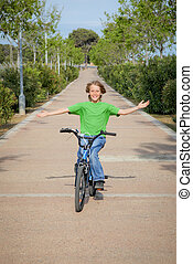 confident child riding bike or bicycle