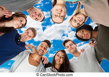 Confident College Students Forming Huddle