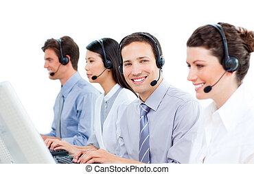 Confident customer service agents working in a call center...