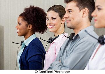 Confident Customer Service Representative Standing With...