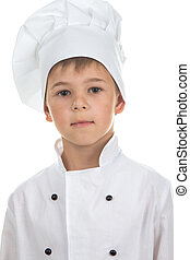 Confident cute boy in Chef uniform on white background