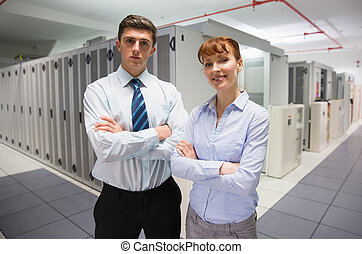 Confident data technicians looking at camera
