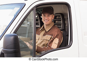 Confident Delivery Man Smiling In Truck