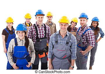 Confident diverse team of workmen and women