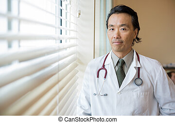 Confident Doctor In Hospital Room - Portrait of confident ...