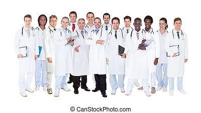 Confident Doctors Against White Background - Large group...