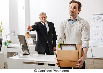 Confident employer firing the employee from the company