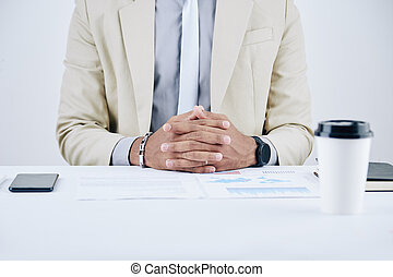 Confident entrepreneur at office desk