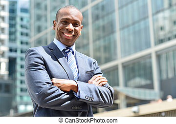 Successful businessman posing with crossed arms