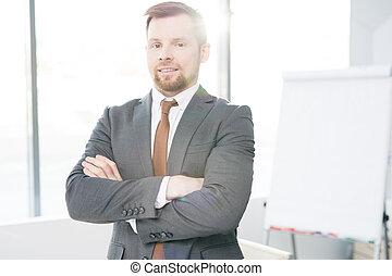 Confident Entrepreneur Posing in Office