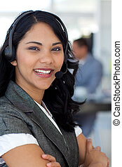 Confident ethnic businesswoman in a call center