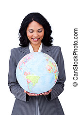 Confident ethnic businesswoman smiling at global business
