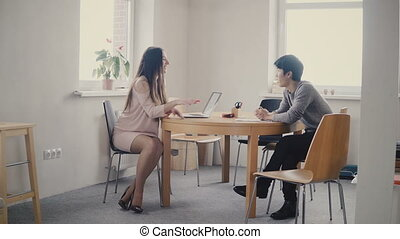 Confident European female lawyer talking to young Japanese...