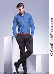 confident fashion man standing with hands in pockets