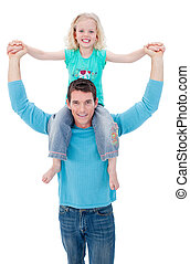 Confident father giving his daughter piggyback ride