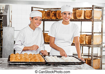 Confident Female Baker's Analyzing Dough At Table