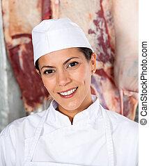 Confident Female Butcher Smiling In Butchery